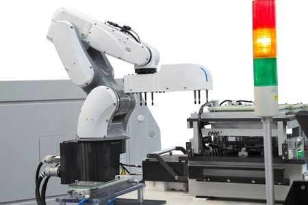 Robot picking printed circuit boards in semiconductor industry